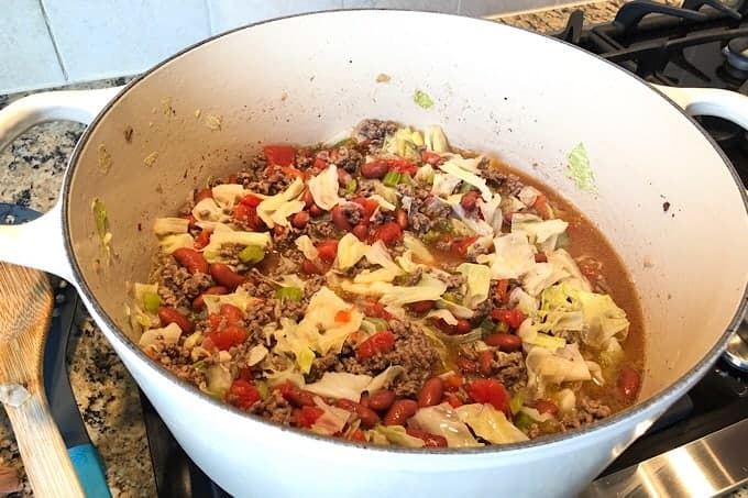Beef and Cabbage Soup in a white Le Creuset Dutch Oven