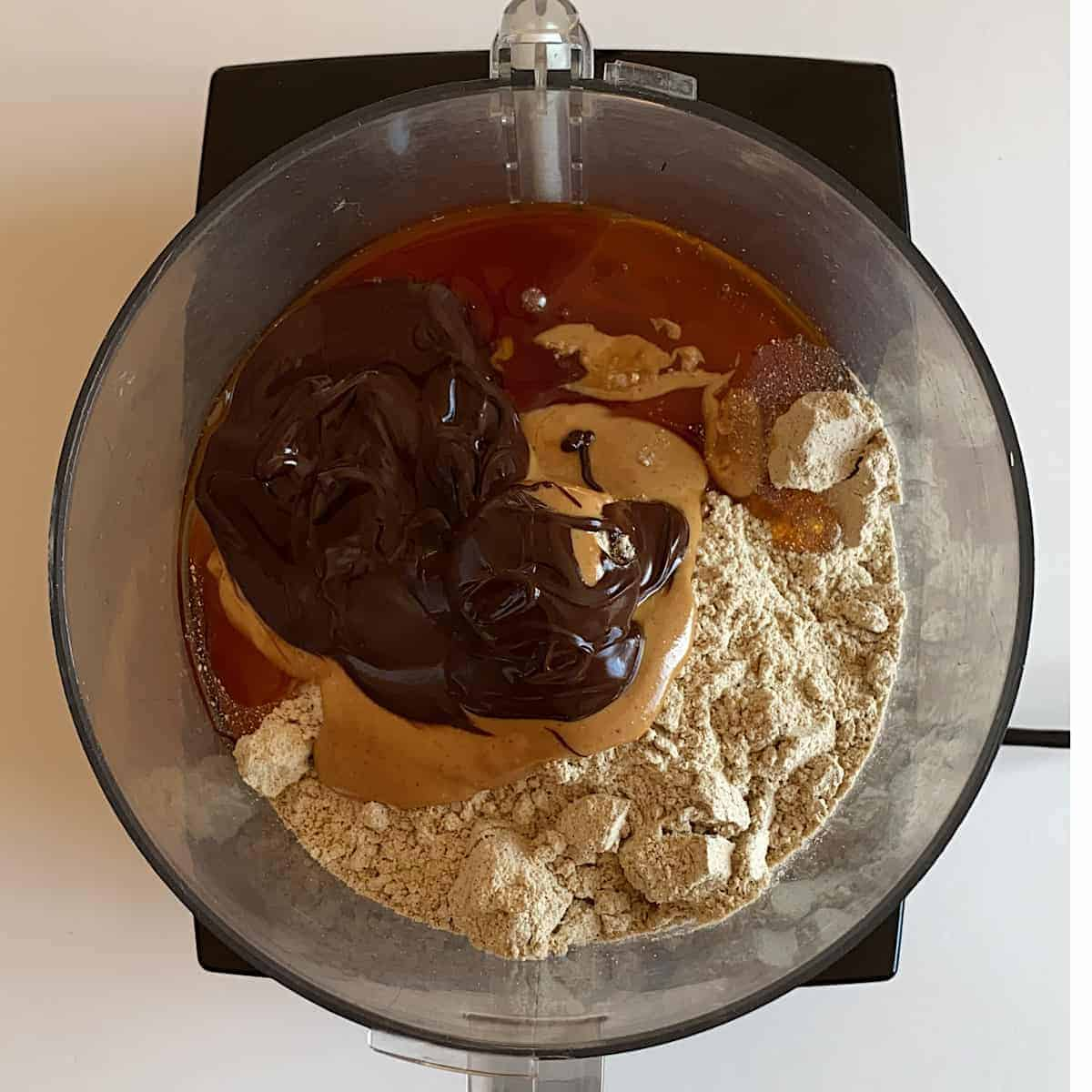 Image of measured Ingredients for Chocolate Peanut Butter Protein Balls in food processor.