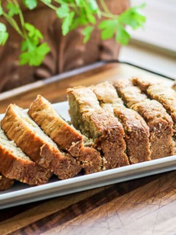 Sliced Best Banana Bread on a rectangular, white plate.
