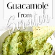 Image of a bowl of delicious guacamole with chip dipped.