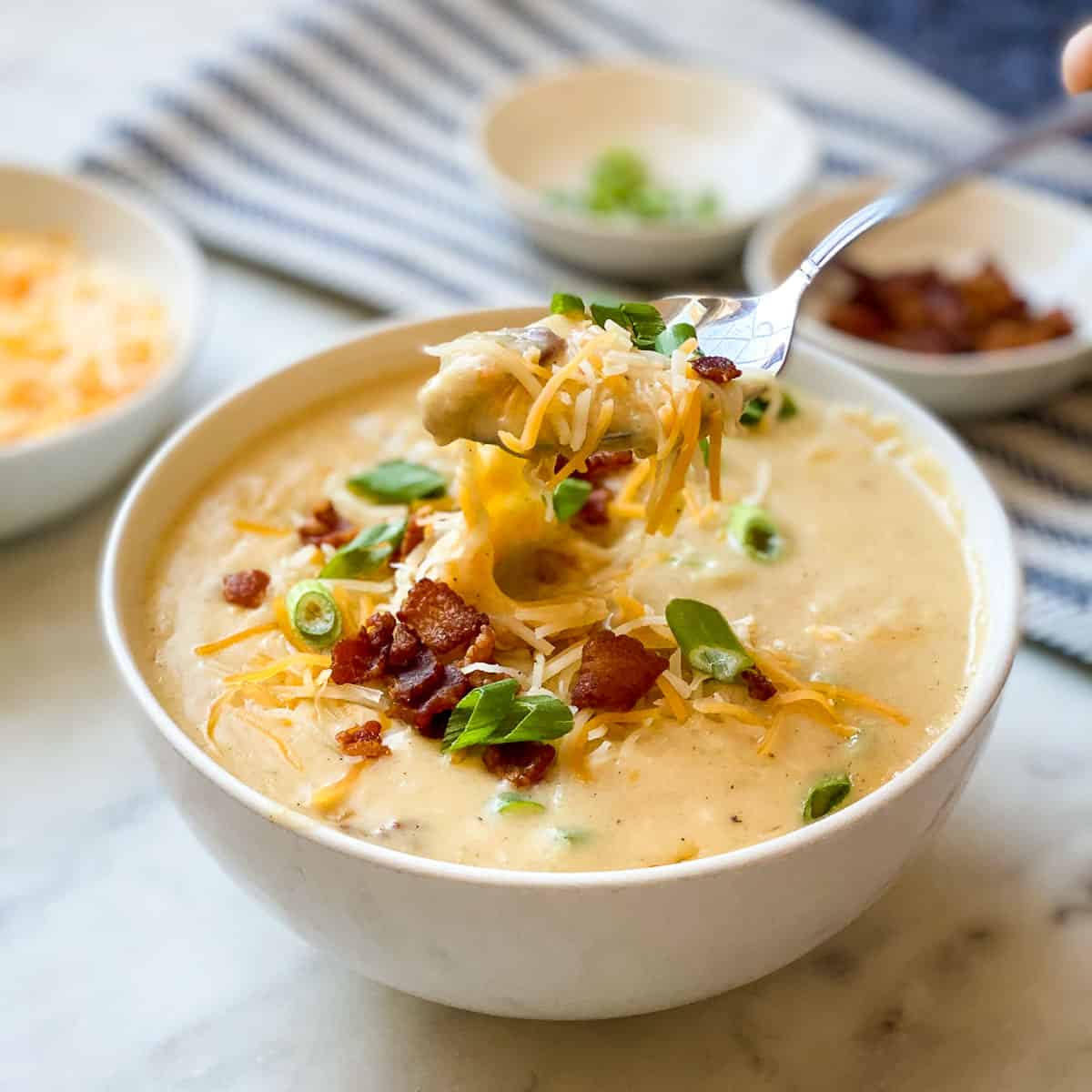 Image showing spoonful of delicious cheesy Potato Soup.