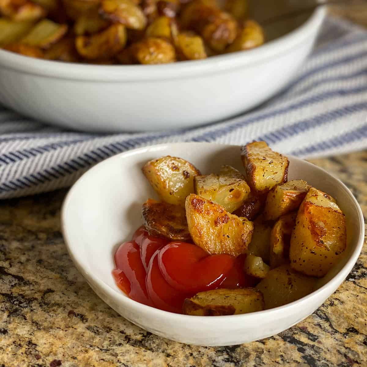 Crispy Oven Roasted Potatoes with Ketchup.