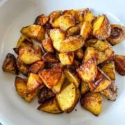 Crispy Oven Roasted Potatoes on a white plate.