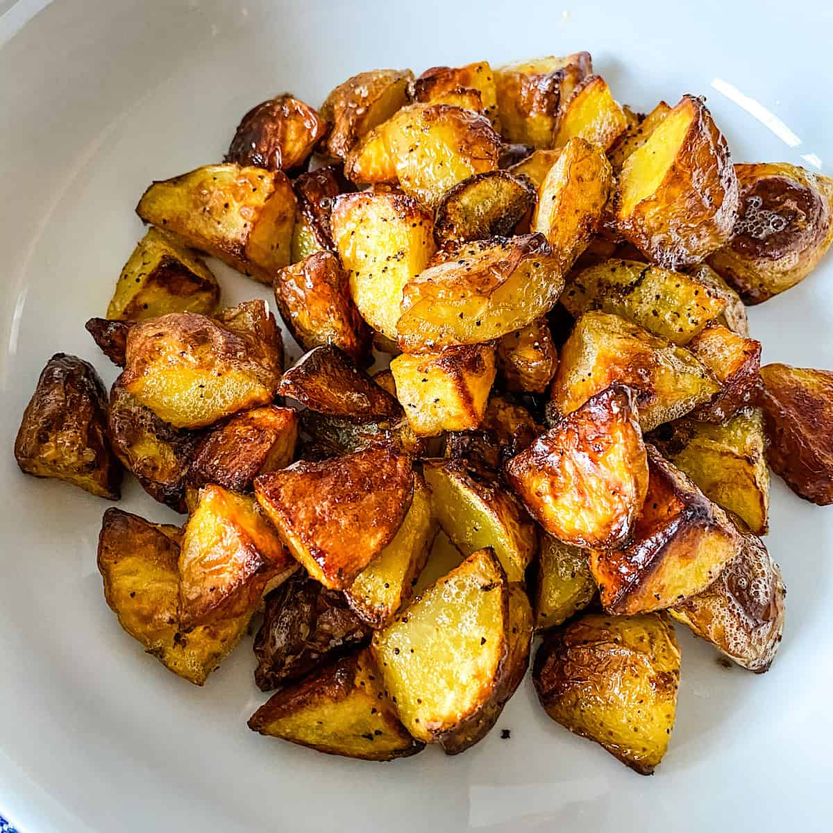 Roasted Potatoes on a white plate.