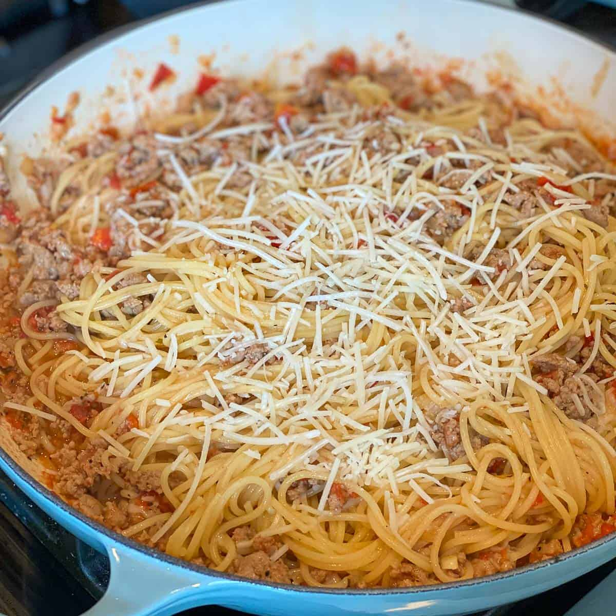 Image of Ground Turkey Pasta Recipe with grated parmesan cheese.